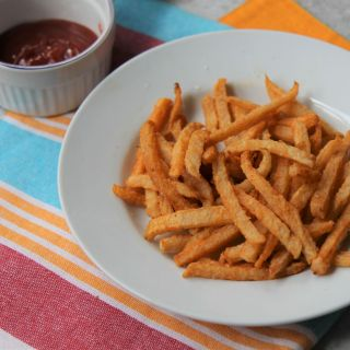 Jicama Fries - Baked Low Carb Keto French Fries with Spices - recipe by media registered dietitian nutritionist Christy Brissette president of 80 Twenty Nutrition