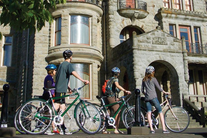 Cruise past the stunning Craigdarroch Castle. Photo: The Pedaler Bicycle Tours