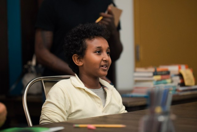 An AWL student smiles in the 826DC writing center.
