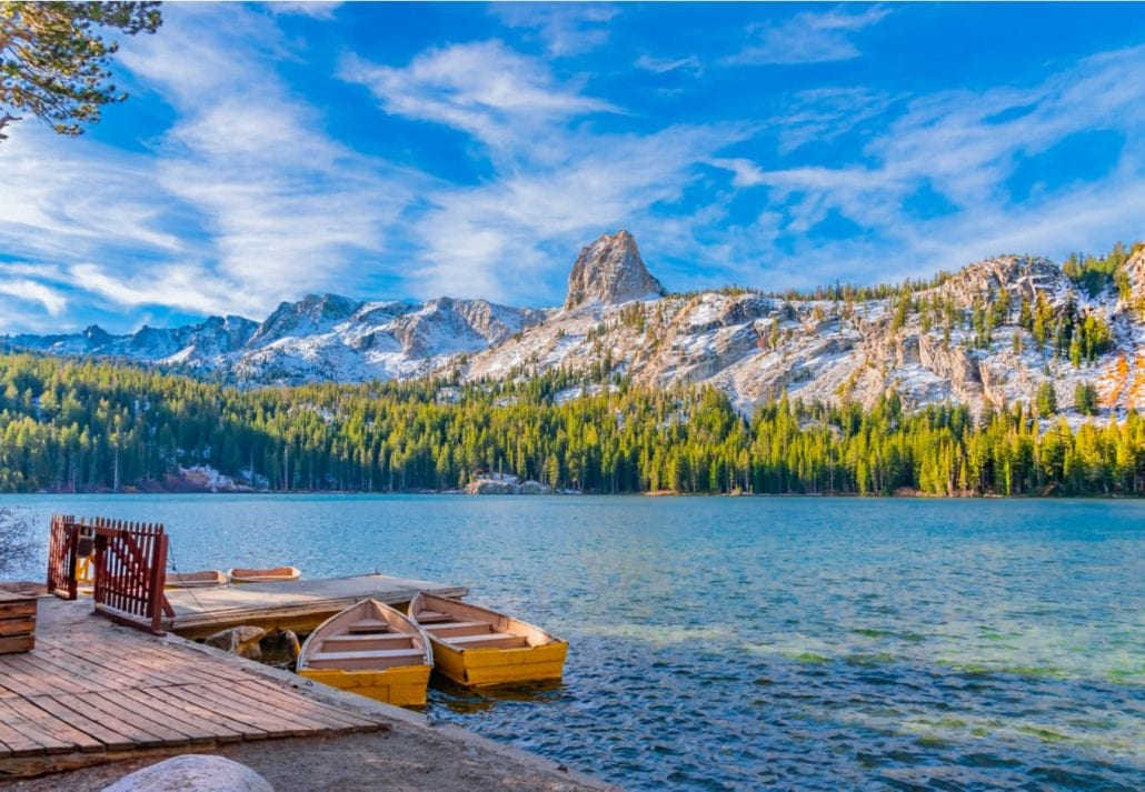 Boats sit at the dock at Lake George under the watchful eye of the Crystal Crag peak. This peak is in Mammoth Lakes in Central California, in Sierra Nevada Mountains.