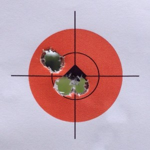 "Five shots at 100 yards. The inner circle is 0.75""."