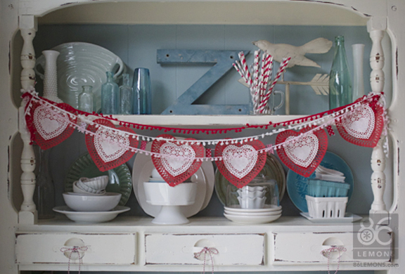 Easy Valentine Garland using paper lace hearts from the dollar bin at Target  86lemons.com