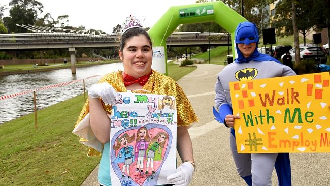 Taylah Devlin, with a super-hero friend, are raising awareness about the capabilities of people with disabilities. Image source: Fairfield Advance