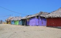 Painted Bamboo Huts on the Beaches of San Clement, Ecuador.