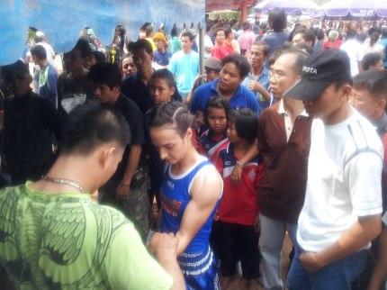 Putting Gloves on - Isaan - Muay Thai