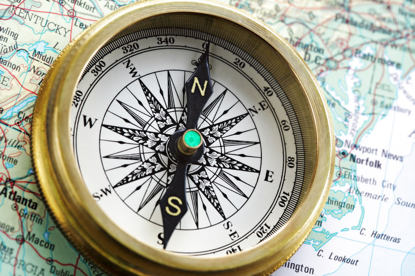 25395343 - old brass compass on map