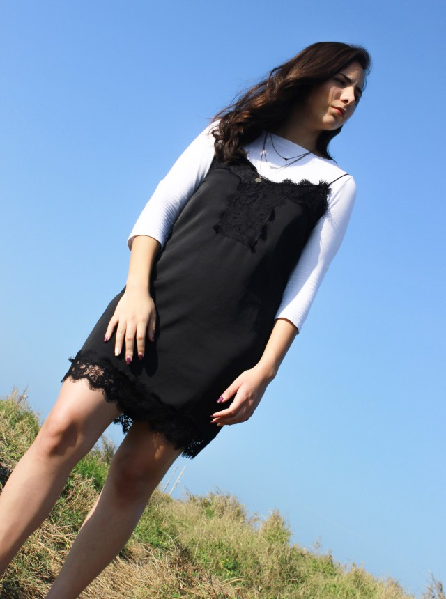 How to style a simple pretty little black slip dress for fall/winter with just a shirt. See the whole outfit at www.8vaavenida.com