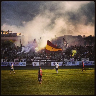 A view of the supporters' section celebrating at a Detroit City FC home game.