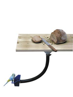 Tabla para cortar pan que da migas a los pájaros