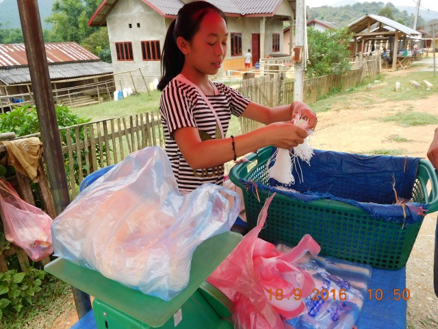 The rice breads are then cut into thin stripes as noodles. We bought some from this little girl.
