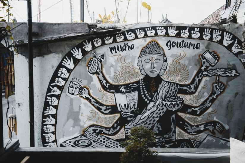 original painting of gautama buddha on wall of shabby house