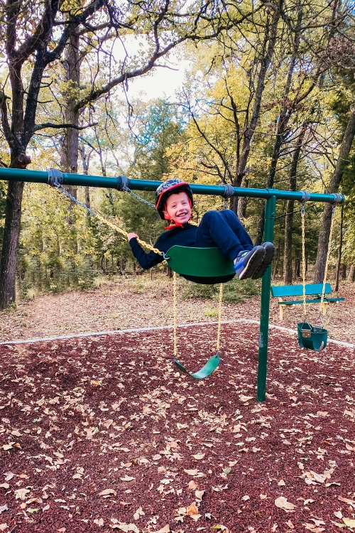 boy swinging at a park