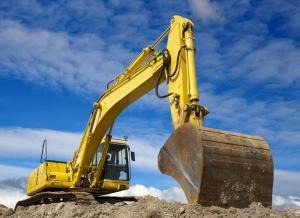 breaking ground tractor-digging-in-dirt