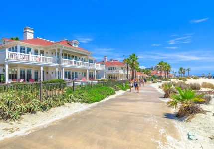 San Diego, California, United States - August 1, 2018: sidewalk by beachfront cottages of Hotel del Coronado built in 1888, historic Victorian beach resort in Coronado Island, Californian west coast.