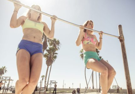 Twin sisters training in Venice Beach.