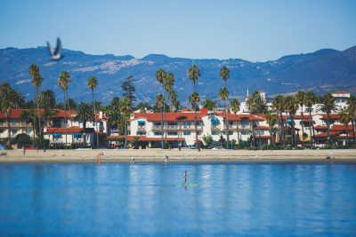 East Beach Santa Barbara ocean front walk, with beach and marina, palms and mountains, Santa Ynez mountains and Pacific Ocean, Santa Barbara county, California, United States, summer sunny day