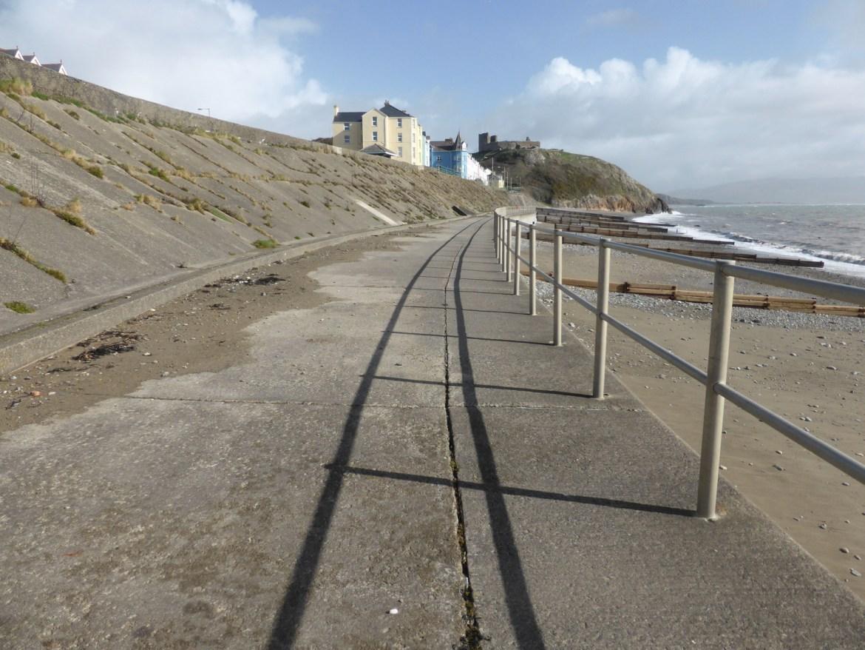 railings shadow along path