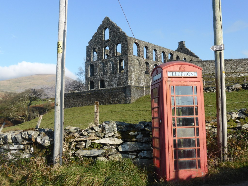 red phonebox and ruined mill