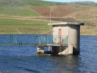 round concrete reservoir valve house