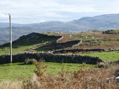 curvy stone wall snaking across hillside