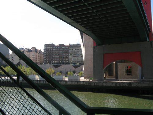 under-roadbridge shadows on river