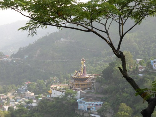 golden buddha on hillside