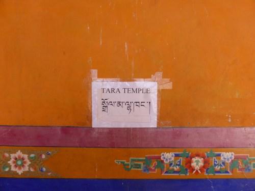 Tara Temple - sign on ochre wall