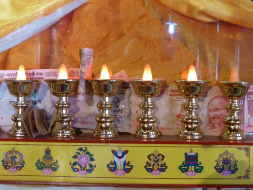 neat row of butterlamps on altar