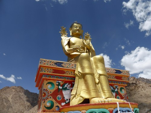 golden buddha on painted throne