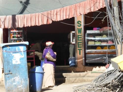 woman entering sweetshop