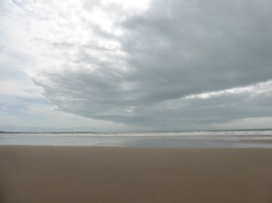 cloud front moves across beach