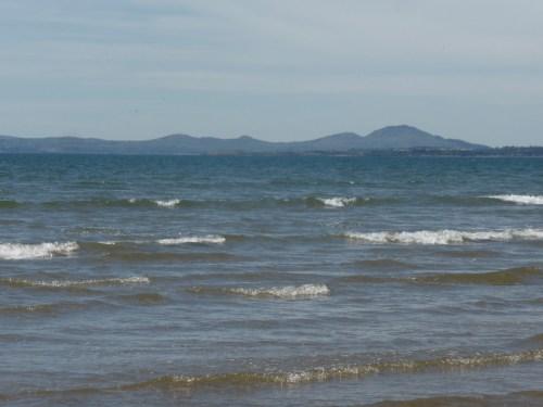 Llyn skyline across blue sea