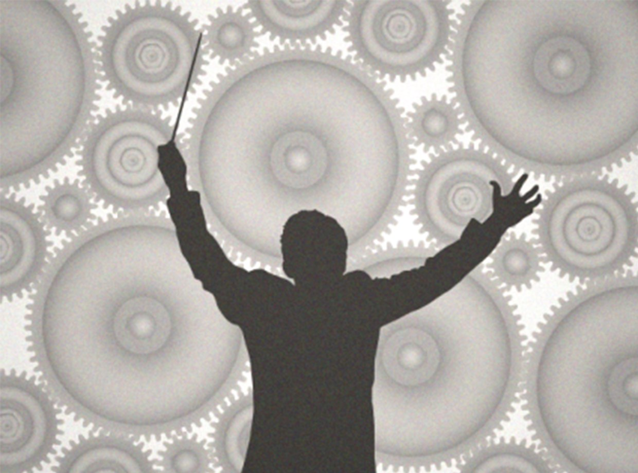 Silhouetted figure of a conductor with his arms up against a background of cogs