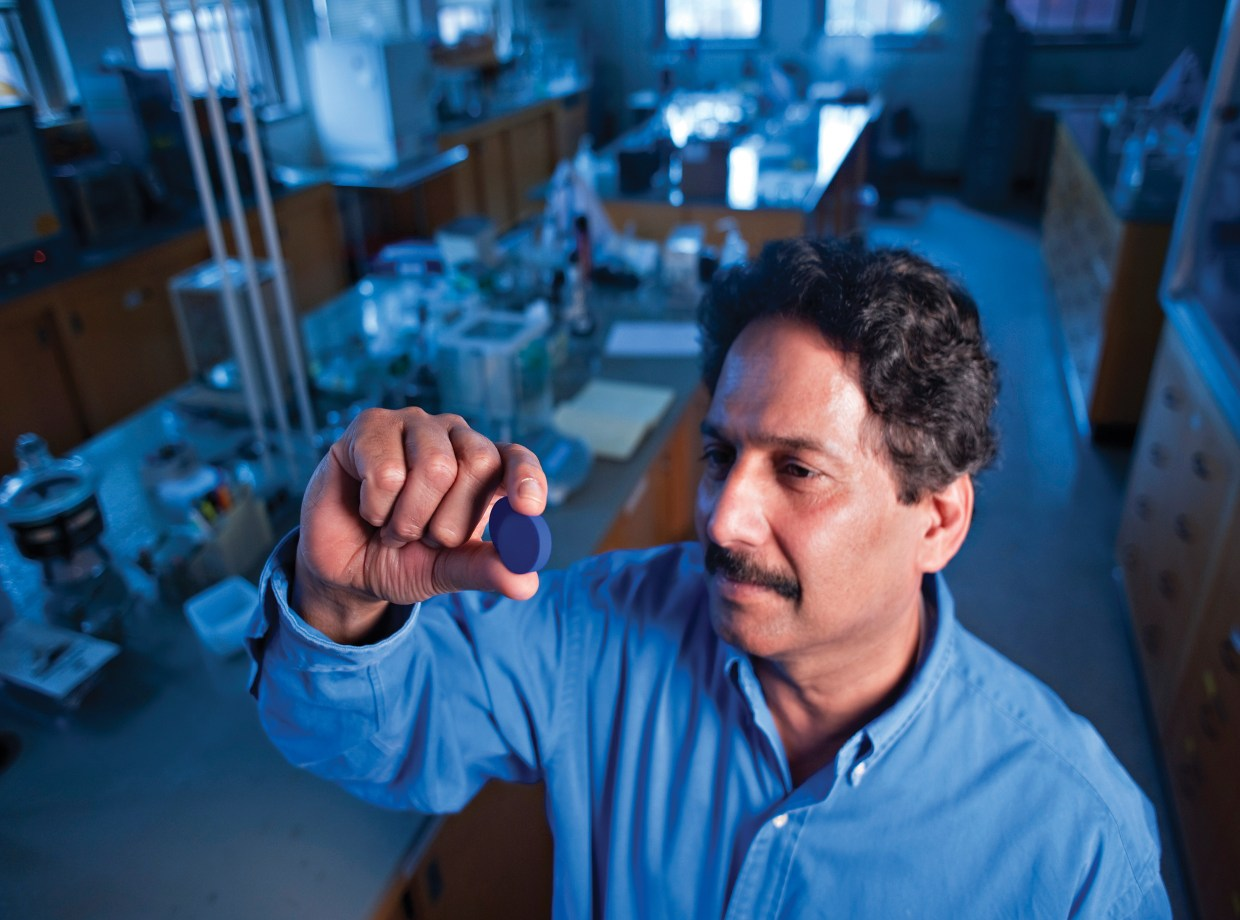 Mas Subramanian looks at his new discovery, a new pigment of blue called YInMn. Image courtesy of Oregon State University.