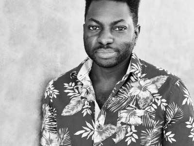 Black and white image of Jamal Dauda in flowered shirt