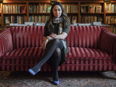 Dr. Sahar Yousef seated on sofa in library.