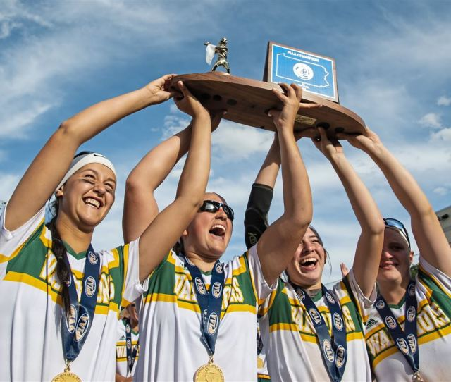 Penn Trafford Seniors Hold Up The Championship Trophy After The Piaa 5a Championship Game On