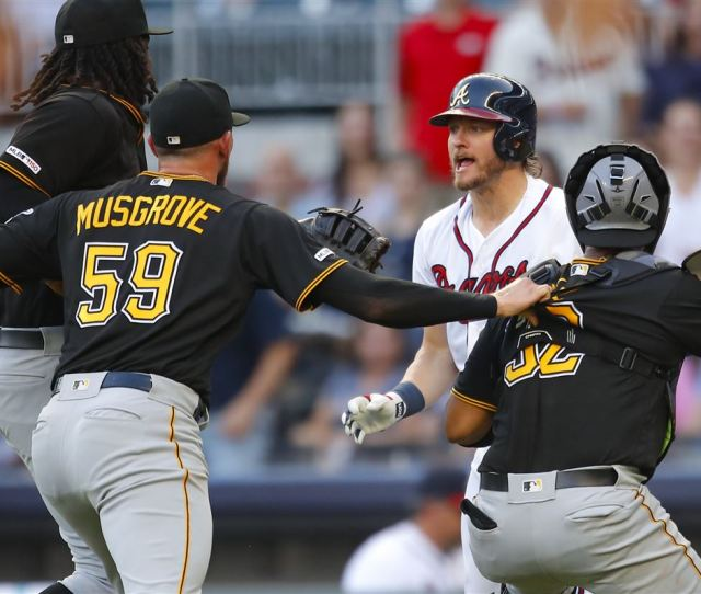 Josh Donaldson Of The Atlanta Braves Is Restrained After Being Hit By A Pitch As He