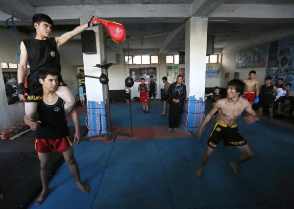 Abbas Alizada, who calls himself the Afghan Bruce Lee, works out during a media event in Kabul