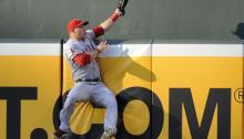 Angels'' Mike Trout makes a leaping catch to rob Orioles shortstop J.J. Hardy of a home run.