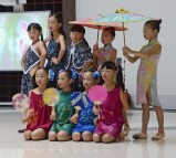 """The students from Qiuzhi Primary school perform their """"Silk Road"""" dance at the 9ISS opening ceremony"""