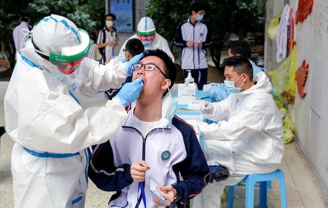 China Reports 12 New Coronavirus Cases Versus Four A Day Earlier