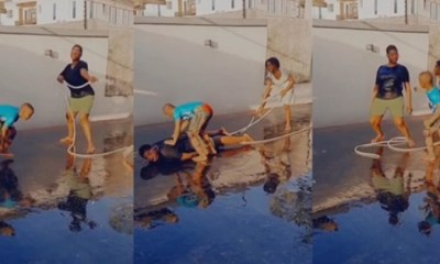 Mercy Johnson uses water hose with kids