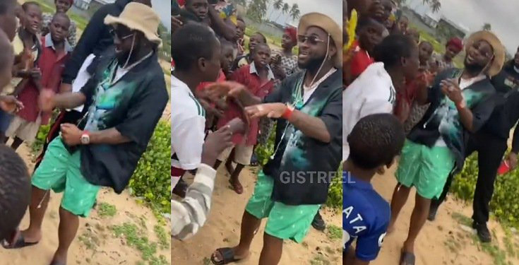 Davido captured singing and dancing with kids on the street (Video)