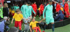 Cristiano Ronaldo makes history as he walks with disabled girl onto field (Photos)