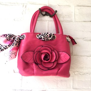 pink purse with flower and scarf