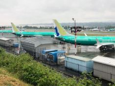 A row of three green 737 MAX jetliners sit parked on the tarmac at Renton Municipal Airport in Renton, Washington, U.S. May 16, 2019. REUTERS-Eric Johnson