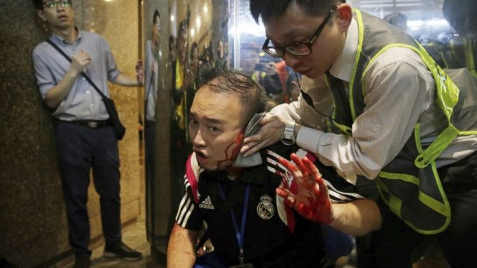 Hong Kong protests: Knife attacker bites man's ear after stabbing four