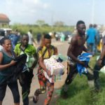 Nigerians carrying food items collected from Covid-19 Palliatives Warehouse