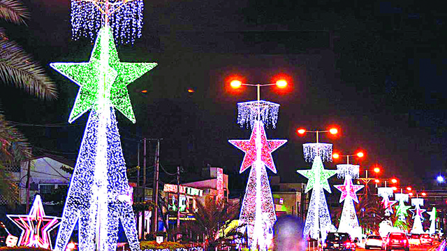 Star lights decorate a commercial street at Christmas in Lagos Nigeria - 9News Nigeria